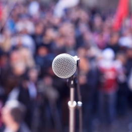 A microphone in front of a crowd
