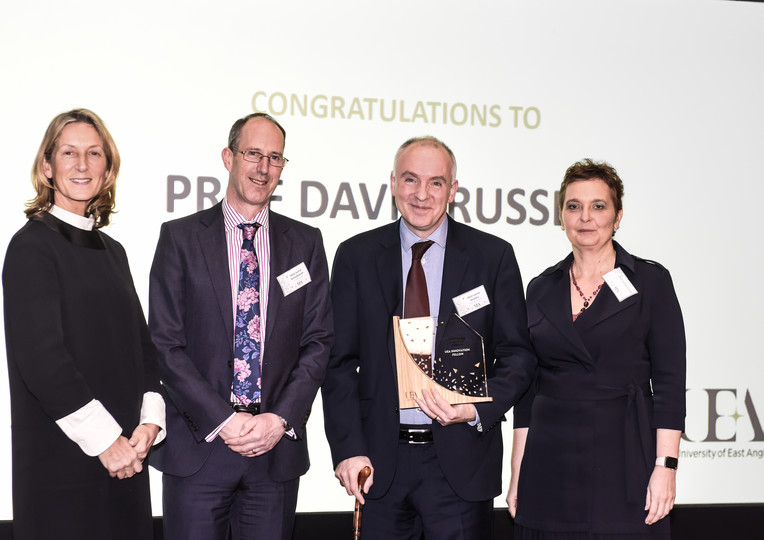Professor David Russell receiving his Impact and Innovation Award from UEA's Chancellor Karen Jones CBE, Professor David Richardson (Pro-Vice-Chancellor) and Professor Fiona Lettice (Pro-Vice-Chancellor Research and Innovation).
