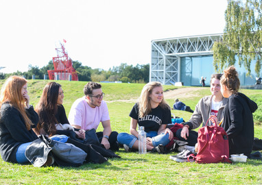 UEA students sitting on campus near the Sainsbury Centre