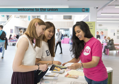 UEA students speaking with a Student Union representative.
