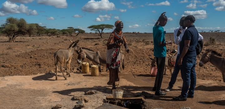 African farmers at well with donkeys