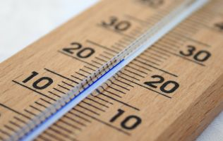 Close up of a wooden thermometer