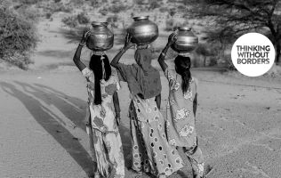 women carrying pots