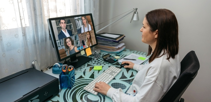 Woman working from home on video conferencing work meeting