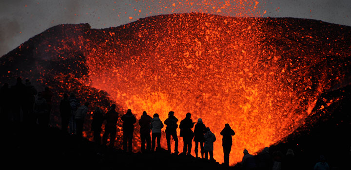 Students studying a volcano